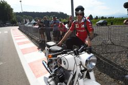 Sebastian Vettel, Ferrari arrives at the track on a vintage BMW motorbike