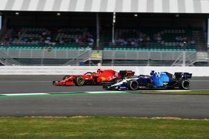 George Russell, Williams FW43B, passes Carlos Sainz Jr., Ferrari SF21