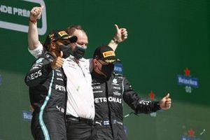 The Mercedes trophy delegate, Lewis Hamilton, Mercedes, 1st position, and Valtteri Bottas, Mercedes, 3rd position, on the podium