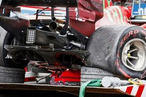 The damaged car of Charles Leclerc, Ferrari SF21, on a truck