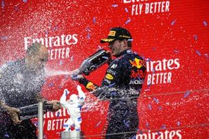 Max Verstappen, Red Bull Racing, 1st position, and Gianpiero Lambiase, Race Engineer, Red Bull Racing, spray Champagne on the podium