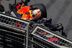 Max Verstappen, Red Bull Racing RB16B, climbs out of his car after hitting the wall