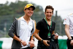 Lando Norris, McLarenwalks the track with Sacha Fenestraz