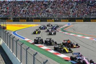 Sergio Perez, Racing Point RP19, leads Nico Hulkenberg, Renault F1 Team R.S. 19, Max Verstappen, Red Bull Racing RB15, Kevin Magnussen, Haas F1 Team VF-19, Romain Grosjean, Haas F1 Team VF-19, and the remainder of the field at the start