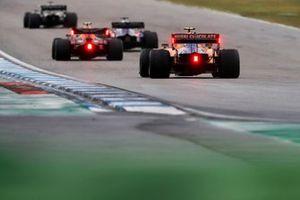 Pierre Gasly, Red Bull Racing RB15, leads Lando Norris, McLaren MCL34