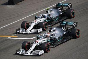 Pole man Lewis Hamilton, Mercedes AMG F1 W10, and Valtteri Bottas, Mercedes AMG W10, arrive on the grid