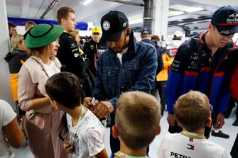 Lewis Hamilton, Mercedes AMG F1, signs some autographs for young fans