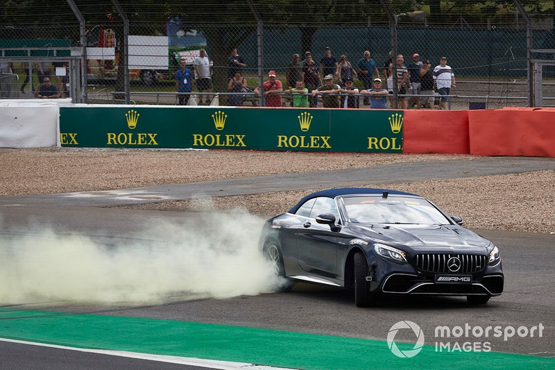 Lewis Hamilton, Mercedes AMG F1, drives Sir Frank Williams in an AMG S 63