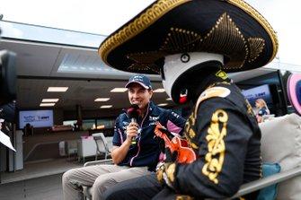Sergio Perez, Racing Point, talks to Mario Achi
