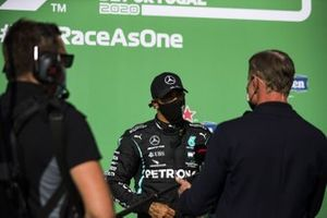 Presenter David Coulthard interviews pole man Lewis Hamilton, Mercedes-AMG F1, after Qualifying