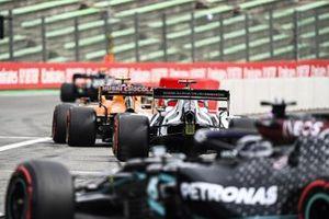 Lando Norris, McLaren MCL35, Pierre Gasly, AlphaTauri AT01, and Lewis Hamilton, Mercedes F1 W11