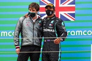 Lewis Hamilton, Mercedes-AMG F1, 1st position, and a Mercedes representative celebrate on the podium
