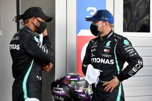 Pole man Lewis Hamilton, Mercedes-AMG F1, and Valtteri Bottas, Mercedes-AMG F1, talk in Parc Ferme