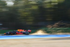 Sparks kick up from the rear of Max Verstappen, Red Bull Racing RB16