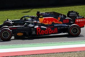 Alex Albon, Red Bull Racing RB16, passes Lewis Hamilton, Mercedes F1 W11