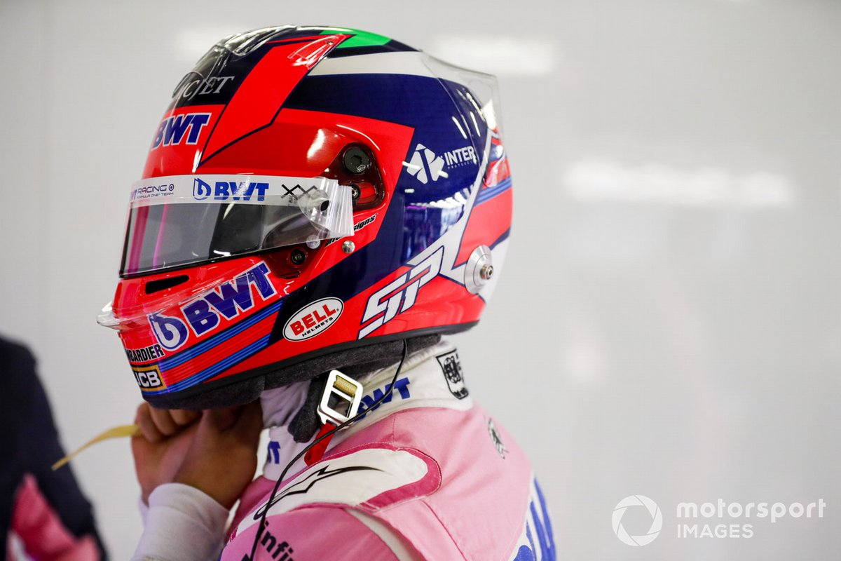 Sergio Pérez, Racing Point, straps his helmet on