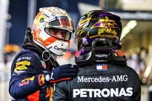 Lewis Hamilton, Mercedes-AMG F1, congratulates Max Verstappen, Red Bull Racing, on securing pole