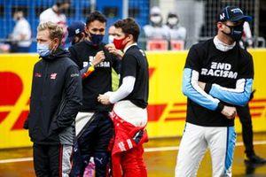 Kevin Magnussen, Haas F1, Alex Albon, Red Bull Racing, Charles Leclerc, Ferrari, and Nicholas Latifi, Williams FW43, on the grid