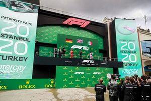 Toto Wolff, Executive Director (Business), Mercedes AMG, Sebastian Vettel, Ferrari, Race Winner Lewis Hamilton, Mercedes-AMG F1 and Sergio Perez, Racing Point celebrate on the podium