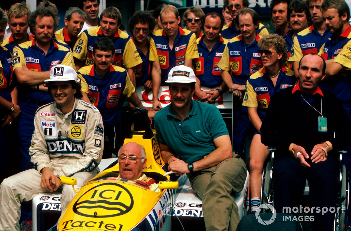 In the midst of the 1986 title fight involving Williams drivers Nelson Piquet and Nigel Mansell, Murray tries to deliver his lines to camera from the confines of the FW11 at the Portuguese Grand Prix.