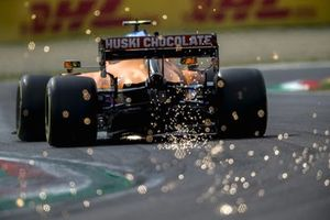 Sparks fly from the rear of Lando Norris, McLaren MCL35M