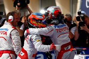 Jarno Trulli, Toyota TF109 hugs Timo Glock, Toyota TF109 as they celebrate taking a 1-2 for Toyota