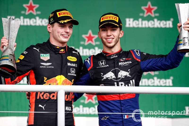 Max Verstappen, Red Bull Racing, 1st position, and Pierre Gasly, Toro Rosso, 2nd position, on the podium with their trophies
