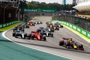 Max Verstappen, Red Bull Racing RB15 leads Lewis Hamilton, Mercedes AMG F1 W10 and Sebastian Vettel, Ferrari SF90 at the start of the race