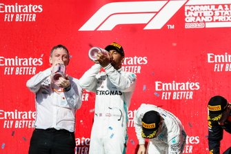 World Champion Lewis Hamilton, Mercedes AMG F1, race winner Valtteri Bottas, Mercedes AMG F1, and James Allison, Technical Director, Mercedes AMG celebrate on the podium with Max Verstappen, Red Bull Racing