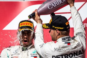 Valtteri Bottas, Mercedes AMG F1, 1st position, pours Champagne over the head of Lewis Hamilton, Mercedes AMG F1, 2nd position, on the podium