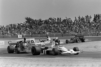 Jody Scheckter, McLaren M23 Ford, Ronnie Peterson, Lotus 72E Ford and Jackie Stewart, Tyrrell 006 Ford