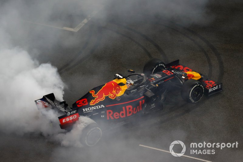 Max Verstappen, Red Bull Racing RB15, 2nd position, performs a celebratory donut on the grid after the race