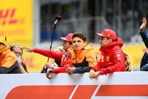 Carlos Sainz Jr., Ferrari, Lando Norris, McLaren, and Charles Leclerc, Ferrari, in the drivers parade