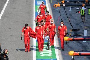 Ferrari mechanics in the pit lane