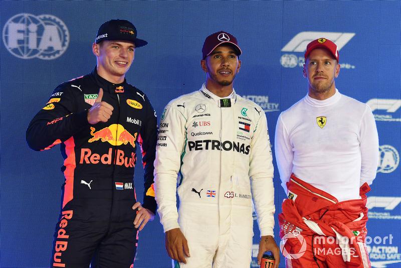 (L to R): Max Verstappen, Red Bull Racing, Lewis Hamilton, Mercedes AMG F1 and Sebastian Vettel, Ferrari celebrate in parc ferme