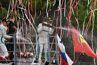 Lewis Hamilton, Mercedes AMG F1 and Valtteri Bottas, Mercedes AMG F1 celebrate on the podium with the champagne