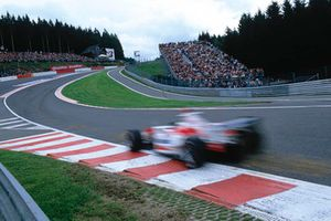 A Toyota driver heads into Eau Rouge