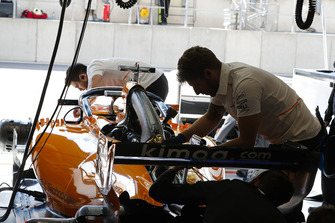 McLaren engineers work on the car of Fernando Alonso, McLaren MCL33, in the garage