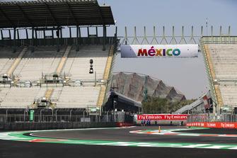 Toro Rosso team members walk through the stadium section
