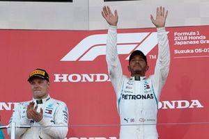 Lewis Hamilton, Mercedes AMG F1, celebrates his win on the podium with Valtteri Bottas, Mercedes AMG F1