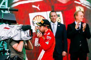 Sebastian Vettel, Ferrari, 2nd position, kisses his trophy