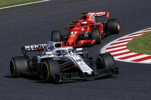 Lance Stroll, Williams FW41 et Sebastian Vettel, Ferrari SF71H