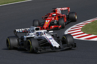 Lance Stroll, Williams FW41 and Sebastian Vettel, Ferrari SF71H
