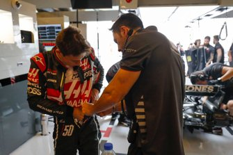 Louis Deletraz, Haas test and development driver, adjusts his overalls in the team's garage