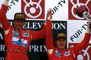 Podium: race winner Ayrton Senna, McLaren, third place Mika Hakkinen, McLaren