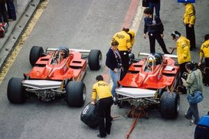 Gilles Villeneuve, Ferrari 312T5, drives past Jody Scheckter, Ferrari 312T5, in the pit lane