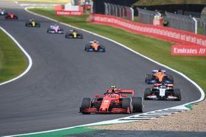 Charles Leclerc, Ferrari SF1000, Romain Grosjean, Haas VF-20, Carlos Sainz Jr., McLaren MCL35, and Lando Norris, McLaren MCL35