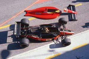 A Ferrari 640 in the pit lane with its bodywork off