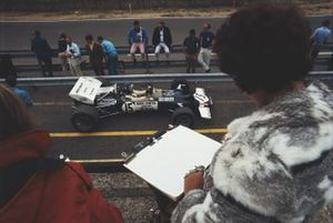 Bette Hill timekeeping for husband Graham Hill, Lotus 49C Ford, during practice
