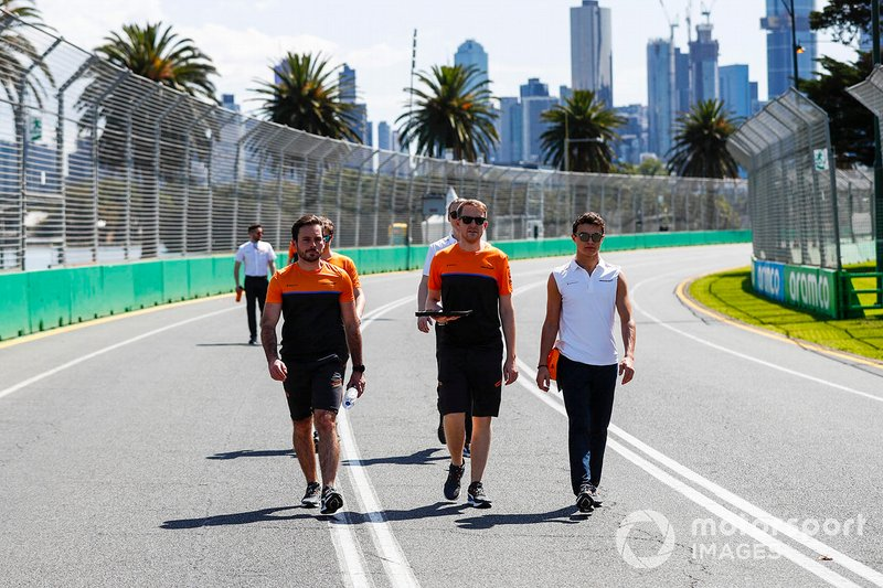 Lando Norris, McLaren and members of the team walk the track